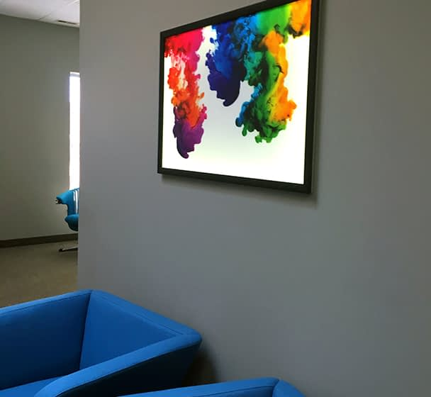 LED Light panel lit and hung on a conference room wall